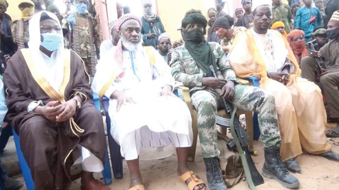 This is Sheikh Ahmed-Mahmoud-Gummi and Bandits at the Zamfara Forest negotiating. This is how low this country has been reduced. Now we negotiate to pay Bandits to stop killings of innocent Nigerians.