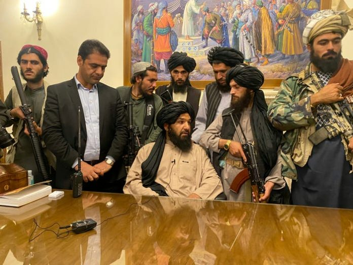 Taliban fighters take control of Afghan presidential palace after the Afghan President Ashraf Ghani fled the country, in Kabul, Afghanistan, Sunday, Aug. 15, 2021. Multiple misleading videos and doctored images purporting to show the situation are now spreading online. AP Photo/Zabi Karimi